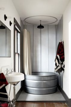 16 Creative Ways to Transform Your Home and Backyard with Stock Tanks During your next bathroom renovation, infuse some rustic flair into your bathroom by asking your contractor to install one of these beauties. See more at Stickett Inn. House Bathroom, Bathroom Renovations, Next Bathroom, Rustic Bathtubs, Rustic Bathrooms, Bathrooms Remodel, Rustic Shower, Bathroom Design, Bathroom Renovation