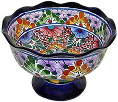 Whether you keep fresh fruit or wax fruit in your house on display, this Talavera fruit bowl is the perfect dish for display. Many of these Talavera fruit bowls can also double as a punch bowl for when you throw parties. Each is handmade and hand-painted by skilled artists in Mexico. By using modern, high-temperature kilns each Talavera fruit bowl is sure to have a strong and durable finish making them crack and chip resistant.