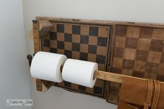 Checkerboard toilet paper holder / Salvaged farmhouse bathroom makeover via http://www.funkyjunkinteriors.net/