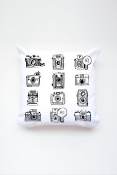 For all the vintage lovers out there, comes this cozy camera set throw pillow featuring 12 different camera models. - Individually cut and sewn in CA - Front print - Concealed zipper - Machine washabl