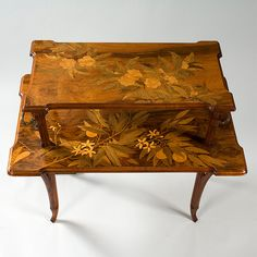 Emile Gallé French Art Nouveau Table featuring marquetry which is a decorative pattern inlaid in furniture and is done with small pieces of variously colored wood or other materials..
