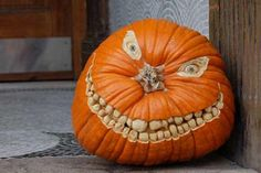 Put a unique spin on your jack-o-lantern , by using the stem as a nose.
