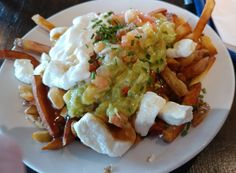 Poutine with a Mexican twist! You will need French fries Beef gravy Fresh cheese curds Guacamole Salsa Sour cream  Add the fries to a bowl. Top with fresh cheese curds and gravy. Add salsa, sour cream and a dollop of guacamole. Enjoy! This local delicate can be found at the St. Albert Cheese Factory in St. Albert Ontario and is not for the faint of heart!