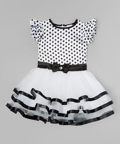Fashionable darlings rejoice over this dress' vibrant polka dots and ruffled skirt. Plush fabric keeps her comfy through every twirl.