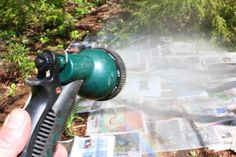 smother weeds in flower beds with newspaper, spray with water, then cover with mulch (shredded leaves, shredded wood chips...)