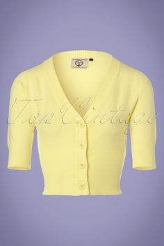 The 50s Overload Cardigan in Pastel Yellowis an all-time classic! Classy in all its simplicity and therefore THE perfect match with all your vintage items! This short cardi features an elegant V-neckline, 1/2 sleeves and shiny buttons. Made from a fine knitted, pastel yellow viscose blend with a lovely stretch for a perfect fit. The combination possibilities are endless!  V-neckline 1/2 sleeves Row of buttons Stretchy rib board along the neckline, sleeves and bottom Shorter styl...