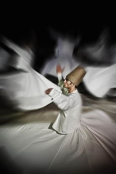Dervish dancer.  This is an amazing sight to behold which we attended, Amah  I.  This is a religious act; not entertainment.  We were told only men were dervish dancer so I am surprised to see women dervish dancers here.