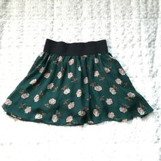 Floral Skirt Adorable floral skirt size: Small. Emerald green with a black elastic waist band. Perfect for summer  Preloved might have a little pulling here or there but nothing noticeable. Heritage 1981 Skirts Circle & Skater