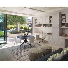 Study wall, round table, poufs, futon couch, kitchen