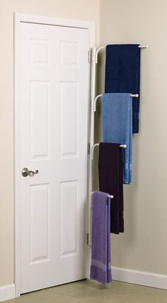 739 DIY Bathroom Storage Ideas : including this multiple-tiered towel rack that hides easily behind the door... great space saver!
