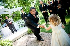 An Orange & Purple Wedding: The Groom comes forward to save the Flower Girl & give her a sweet little treat. http://linnealizphotography.com