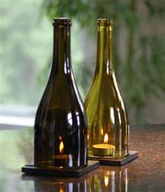 Wine bottle lanterns. I love the idea of cutting the bottom off for glasses, then using the tops like this!