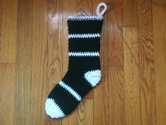 I made these Christmas stockings last year for my husband and son and am about to start another for the new baby! Made of synthetic yarn and