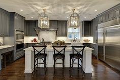 Gray is the new white (or black in some cases) and we love seeing it in kitchen design.