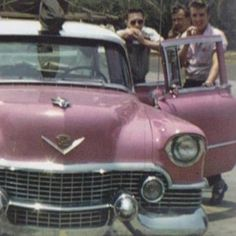 Elvis at Jimmy Rodgers Memorial Festival where Hank Snow, Bill Black and Elvis are parading in Elvis pink Caddy 1955 on May 25, 1955 in Meridian.