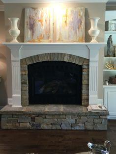 Beautiful arch stone fireplace