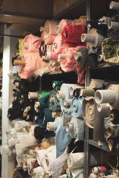 Fashion atelier, behind the scenes at Oscar de la Renta - rolls of fabric; fashion design