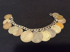 Vintage International Coin Bracelet Custom Made Sterling Siver Bracelet      Item specifics   Condition: Pre-owned      :                An item that has been used or worn previously. See the seller's listing for full details and description of any imperfections. See all condition definitions– opens ...