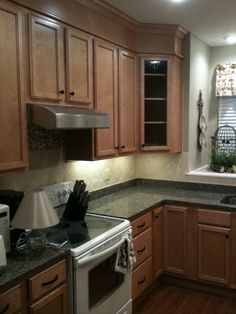 Wellborn Forest Americana Cabinetry Budget Remodel 12 000 For Cabinets Granite Sink Faucet