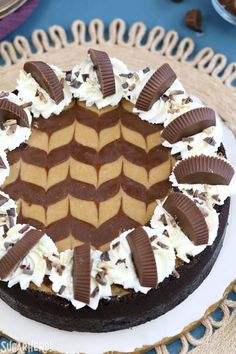 The ULTIMATE Chocolate Peanut Butter Cheesecake! Smooth and creamy, with gorgeous chocolate swirls and lots of peanut butter cups on top! Ultimate Cheesecake, Cheesecake Recipes, Dessert Recipes, Cheesecake Squares, Cheesecake With Whipped Cream, Chocolate Peanut Butter Cheesecake, Chocolate Cake, Nutella, Heavy Cream Recipes