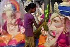 Aug 28, 2016 An artist gives finishing touches to an idol of Lord Ganesha ahead of 'Ganesh Chathurti' in New Delhi. PTI Photo