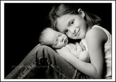 Newborn picture with sibling. I'll be doing this with both of my nieces, the older one holding him and the younger one kissing his forehead!