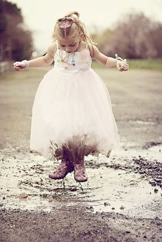 Little Girl Jumping in the Mud.
