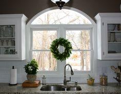 kitchen sink window, subway tile, light granite, white trim and cabinets! Love