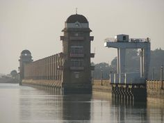 The Tungabhadra dam is constructed across the Tungabhadra River, a tributary of the Krishna River. The dam is located near the town of Hospet in Karnataka.