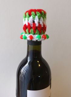 "Pattern of the Day: Christmas Wine Bottle Topper - ""Tis the season for holiday hostess gifts and giving fun things. You're going to love working up this bottle topper just as much as the recipient will love receiving it."