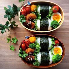 rice, seaweed, broccoli, boiled egg, cherry tomato, sausage, lettuce, korokke (?)
