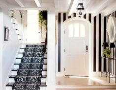 Using Vertical stripes is a great designer trick for making a room feel taller