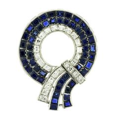 Art Deco Sapphire and Diamond Brooch | From a unique collection of vintage brooches at https://www.1stdibs.com/jewelry/brooches/brooches/