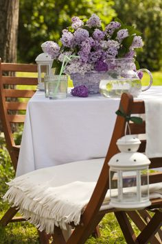 Spring lilac decorated garden table. More images like this at flowerpress.cz