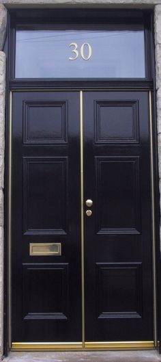 Black double front door + house number http://thayermanor.wordpress.com/