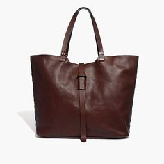 """With hand-stitched details and an inventive loop closure, this soft leather tote is our nod to the artisan aesthetic of the '70s (like something your mom might have picked up on a road trip down Highway 1). Please note: As leather is a natural material, each bag varies slightly in texture and color. We love the way each one wears in differently, taking on a special character all its own. <ul><li>Leather.</li><li>Flap closure.</li><li>Interior pocket.</li><li>8 1/4"""" handle drop.</li><li>13…"""