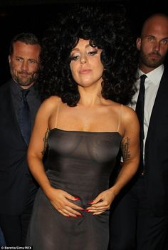 No nip-slips here: The five-time Grammy winner's pasties and golden thong were the onlythi...