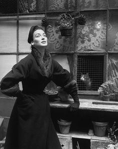Wearing a wool velvet coat with mink collar & cuffs, by Pierre Balmain 1953