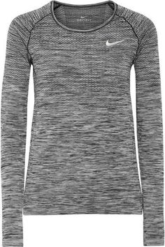 5119854247b Nike's marled top is a lightweight but insulating base layer. Perfect to  wear on hikes or outdoor runs, it's made from signature Dri-FIT stretch  material ...