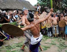 Balinese villagers battle using thorny pandanus leaves and rattan shields during the annual Perang Pandan (Pandanus War) event in Tenganan village, Karangasem-Bali island, June 8, 2012. Although their bodies are splattered with blood, the men are proud as they believe they have made a sacrifice to the gods, to balance the human body and the universe.
