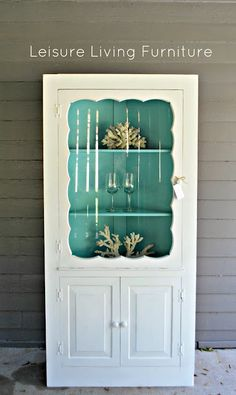 Corner cabinet with Tiffany blue painted interior.