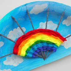 Gorgeous, colorful, and fun! This rainbow craft is such a great one to do with the whole family!