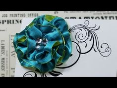How to make an easy ribbon flower using some 1 inch Blue/Green Reversible Satin Ribbon and a Gluber, both available from http://shop.ribboncarousel.com/ http...