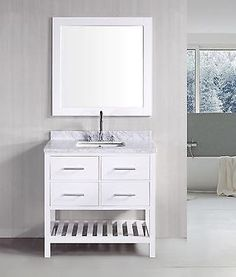 This vanity set is elegantly constructed of solid oak wood. The white marble counter top's classic beauty and contemporary styled cabinetry bring a sophisticated and clean look to any bathroom.  An white framed mirror is included. This beautiful vanity includes four drawers with satin nickel hardware, plus additional open storage space at the bottom.