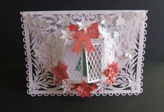 Christmas Bay Window card CraftROBO Cameo on Craftsuprint designed by Tina Fitch - made by angela walker - I cut out all elements on my Cameo Machine, embossed the bay window with a snowflake embossing folder, folded and stuck the bay window as per instructions, stuck it onto the card using glue, layered the poinsettia's and glued to the ribbon, added all other elements using glue. I cut out a few more snowflakes and added to the card. Embellished with small gold gems and used lots of ...