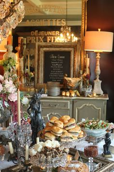 Romancing the Home...I love the buffet table with marble, chandelier, candles, mirrors, crystal..love love love! Someday my kitchen, dining, entertaining area will resemble a shabby chic french countryside.