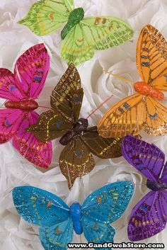 "3"" FEATHER BUTTERFLY W/GLITTER ASSORTED PKG/12"