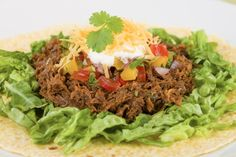 Slow Cooker Chipotle Barbacoa Beef (Copycat)  - pairs well with fresh Guacamole!  -  www.GetCrocked.com