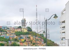 Download this stock image: Low angle view of picturesque colored poor houses at the top of a hill at Cerro Santa Ana in Guayaquil, Ecuador. - FHY8DG from Alamy's library of millions of high resolution stock photos, illustrations and vectors.