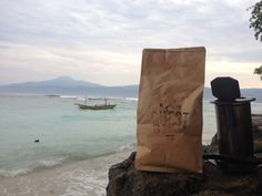 Quest Coffee Roasters coffee beans and aeropress on location in Sumatra Indonesia for surf trip.